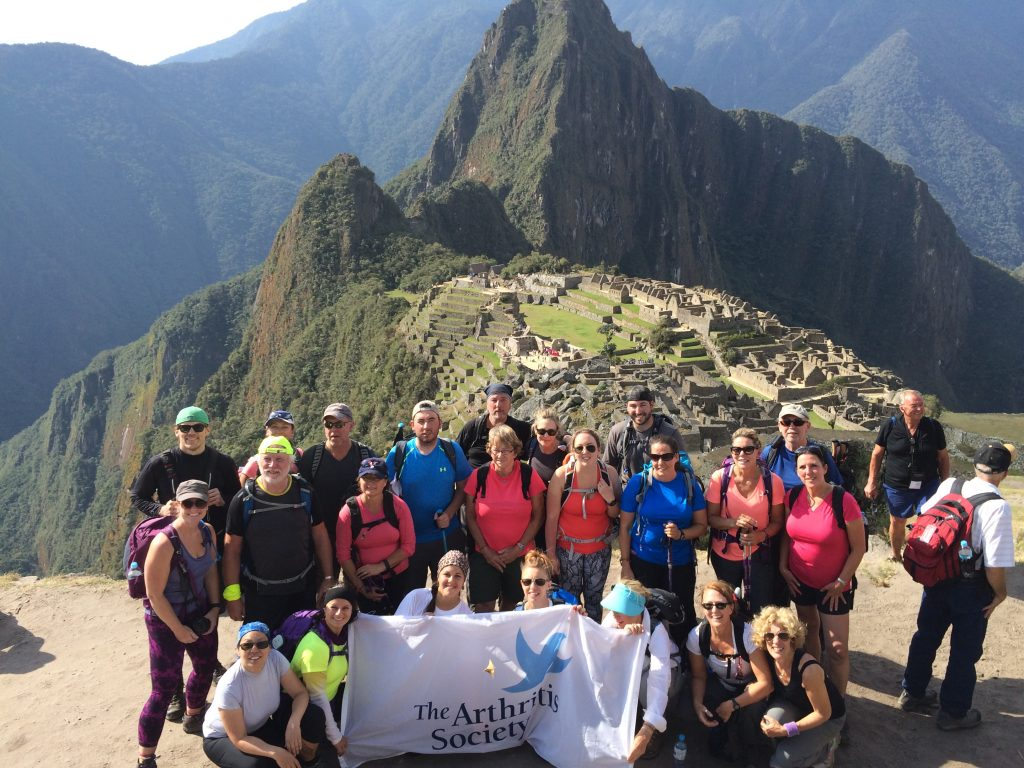 The group summits Machu Picchu.