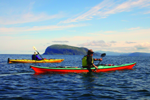 Paddling to Lark Harbour, Newfoundland with Guernsey Island in the background.