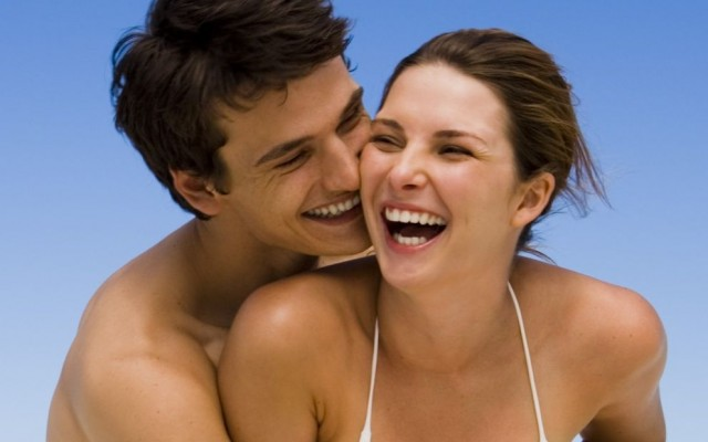 78632420-couple-laughing-at-beach EDIT