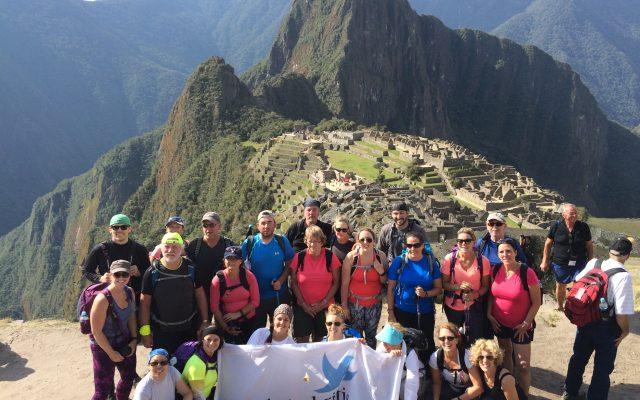 The group summits Machu Picchu.