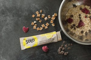 Need a yummy breakfast idea for the weekend to keep you fueled longer? Mix lemon lift bits, berries, granola and cocoa nibs together. Add a little greek yogurt for extra protein! It's simple, quick, and super delicious! #solobar #soloenergybar #lowgi